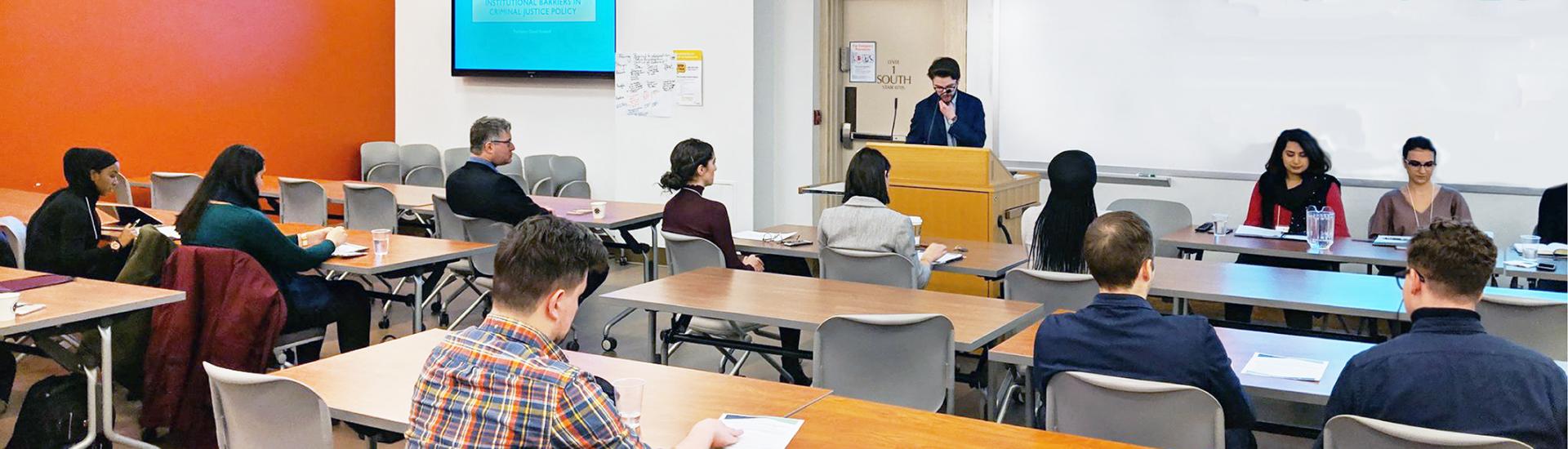 Graduate students present in a classroom